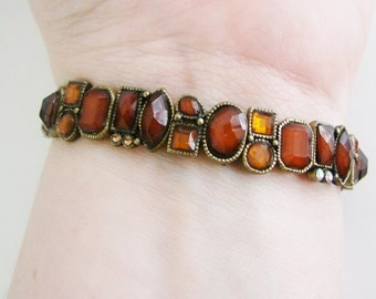 Brass tone stretch bracelet with coffee brown faceted beads and amber/ white crystal accents (P)