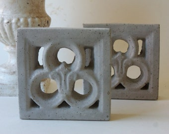 two cement cutwork tiles