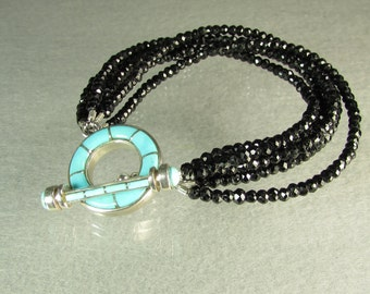 Black Spinel 6 row beaded bracelet with handcrafted blue Turquoise art toggle clasp 7.5""