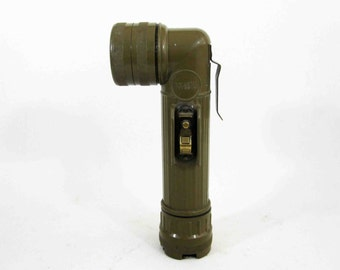Vintage Vietnam Era Military Flashlight in Olive Drab. Circa 1960's - 1970's.