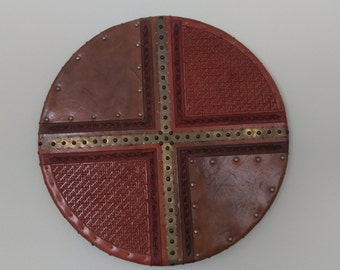 Hand tooled leather shield