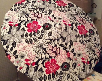black,white and red flower parasol