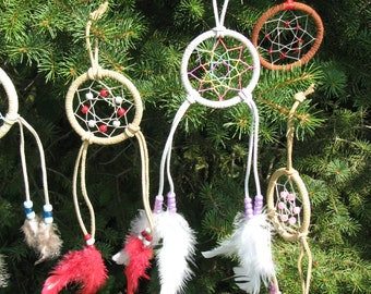 Small dream catchers handcrafted by Shoshone Bannock in Pacific Northwest with suede, beads, and feathers