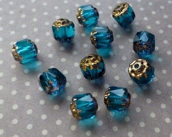 Pack of 40 Czech glass beads blue with gold wash