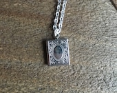 Tiny silver locket necklace with silver chain