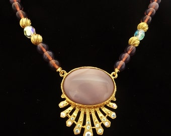 """1928 brand Vintage gold tone & glass lavender beaded 20"""" necklace, attached 1.5"""" rhinestone and lavender stone pendant in unworn condition"""