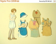 1920s paper doll, brunette girl with white cat, original Sunshine Cutouts doll clothes, blue apron & cap, turn of the century paper ephemera