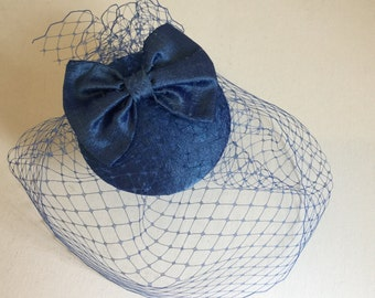 Blue silk bow fascinator, Cocktail hat with birdcage veil.