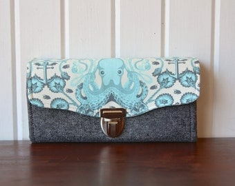 Necessary Clutch Wallet in Octogarden in Aqua with black silver metallic linen