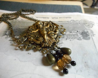 Guardian of When Darkness Falls. Victorian Gothic Cherub Necklace