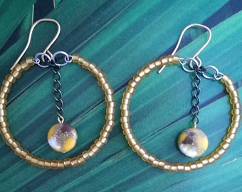 Gold beaded hoops with chain middle
