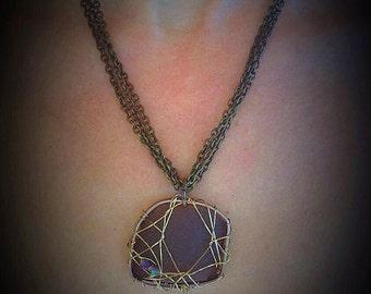Multi strand necklace with sea glass pendant