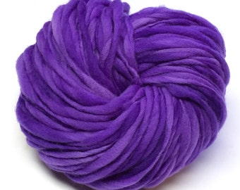Handspun yarn, 100 yards and 3 ounces/86 grams spun thick and thin in hand dyed merino wool
