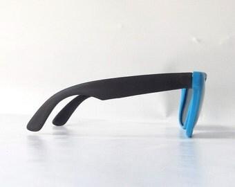 vintage sunglasses. deadstock vintage. black and blue. plastic sunglasses. wayfarer sunglasses. 80s glasses. 1980's. sunglasses. sun glasses