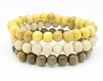 Mens natural graywood and yellow nangka triple pack wooden beaded stretch bracelets