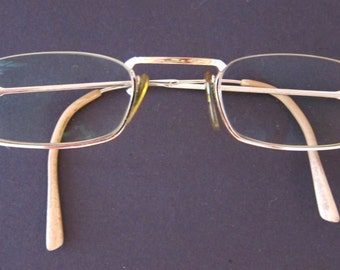 FLAIR gold frame glasses.-