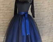 Navy blue tulle skirt tutu for women lined in black satin with a navy satin ribbon waist.
