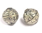 2 BEADS - Tibetan silver  repousse floral design oval shape beads  18 - 19 mm -  BD794