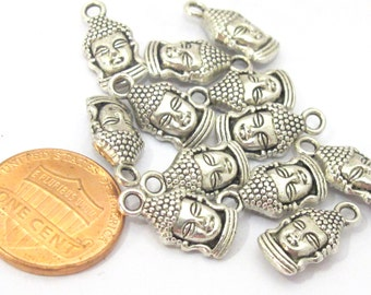 10 charms -  Reversible antiqued silver tone Budddha face charms 16mm x 8mm - CM111s