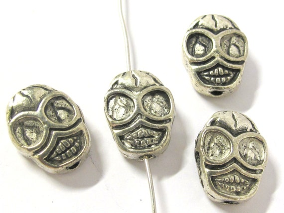 4 Beads - Reversible antiqued silver tone metal skull beads  - BD293A