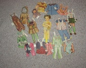 vintage 1940's paper dolls, young girl with many paper clothes. very nice for scrapbooking or collecting
