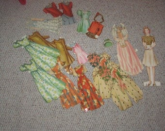 vintage 1940's paper dolls, young women with many paper clothes