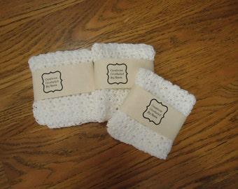 "Three white cotton handcrocheted dishcloths 10"" x 10"""
