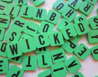 75 vintage plastic letter tiles - anagrams - game pieces - green with black letters