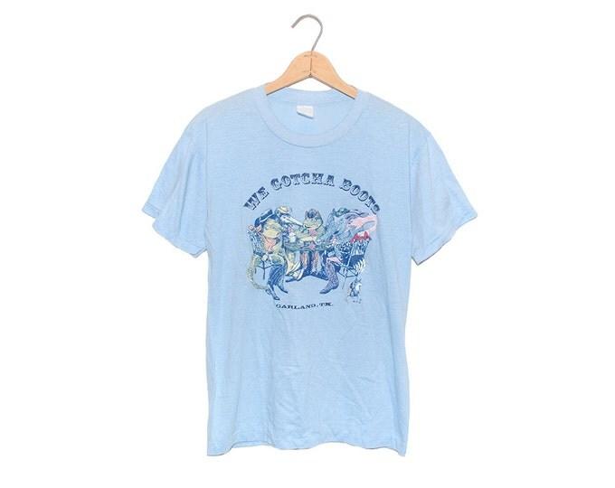 "Vintage 70's ""We Gotcha Boots"" Garland, TX Animal Poker Game Light Blue Poly-Cotton Blend T-shirt - Large"