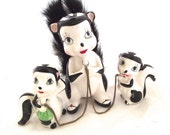 Vintage Skunk Figurines, Three Skunks with Chains and a Fuzzy Tail (E3)