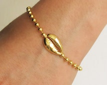 bracelet cauri bracelet or cauris bracelet de coquille de cauris bracelet en or bracelet. Black Bedroom Furniture Sets. Home Design Ideas