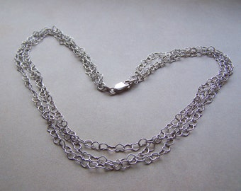Sterling Silver Triple Strand Heart Shaped Links Necklace