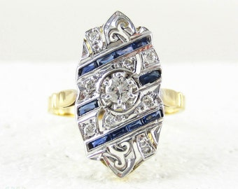French Art Deco Diamond & Sapphire Dinner Ring. Large Panel Shape Cocktail Ring with Blue Baguette Sapphires and Diamonds, Circa 1920s.