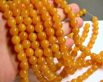 Yellow Jade - 10 mm round  beads - 40 beads per strand - Yellow (orange jade) - RFG540