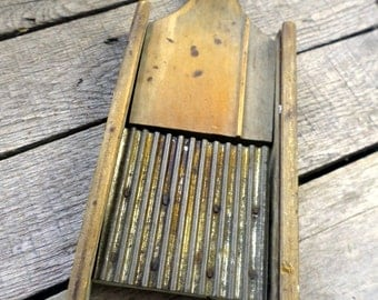 Vintage Cabbage Shredder Metal and Wooden with wooden handle and hole to hang it by measures 13 x 5""