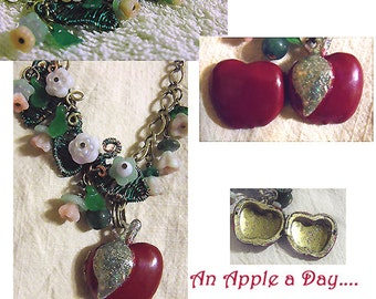 Apple Locket Necklace with wire woven leaves, vintage glass flowers. Whimsy and colorful Wearable Art by Maeve.