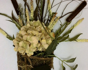 Hydrangea and cattail wall arrangement