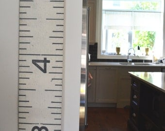 Two (2) Brimfield Growth Charts