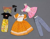 Skipper and Barbie fashion clothes, 7 pieces Orange print dress with white bodice, Pink mini dress with silver lame bustier, denim pants...