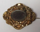 Mid 1800s early Victorian 9ct gold pressed rococco style mourning brooch or pin with beautifully detIles hairwork panel