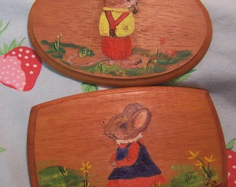 two tiny hand painted plaques