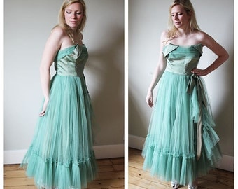 A stunning 1950's teal blue/green tulle and satin dress
