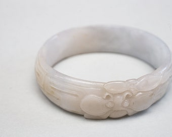 Oval Carved Jadeite Bangle with Moth