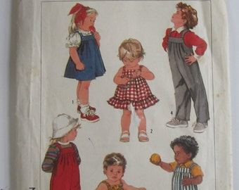 Babies Overalls in Two Lengths Sundress Jumper and Bubble Suit Size 12 mths Vintage 1980's Simplicity Pattern 7790