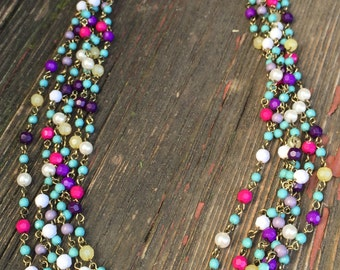 Multi Stranded Beaded Necklace with Faceted Beads