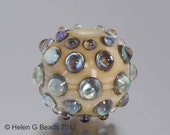 Bumpy, Lampwork Bead in ivory and iridescent green by Helen Gorick