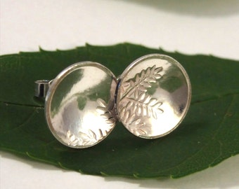Silver Ash Leaf earrings: Sterling Silver discs with an ash leaf texture.