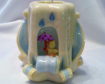 Carved baby shower centerpiece candle