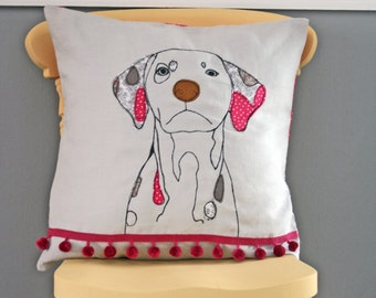 Dog cushion with pom pom detail