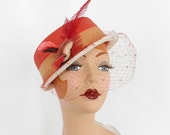 Vintage boater hat with bird, feathers. Red with white trim, red veil